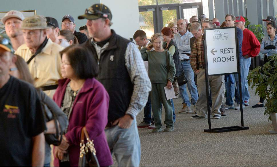 Al Hartmann  |  The Salt Lake Tribune People line up at the polling station at West Jordan Library on election day Tuesday Nov. 8. Polling staff said they were very busy with people qued up at 6:30 a.m. before opening with waits up to two hours mid-morning.  Good thing there is a restroom nearby.