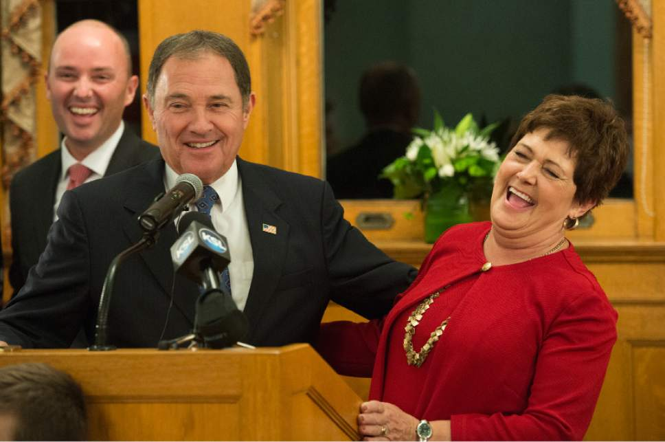 Leah Hogsten  |  The Salt Lake Tribune Incumbent Republican Governor Gary Herbert shares a laugh with wife Jeanette and Lt. Gov. Spencer Cox (left) during his acceptance speech after defeating former CHG Healthcare Services CEO Democrat nominee Mike Weinholtz to seize a third term in office.