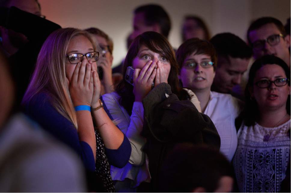 Scott Sommerdorf   |  The Salt Lake Tribune   People in the audience at the Democratic election night party at the Sheraton Hotelon Tuesday react to the announcement that Donald Trump has carried another state.