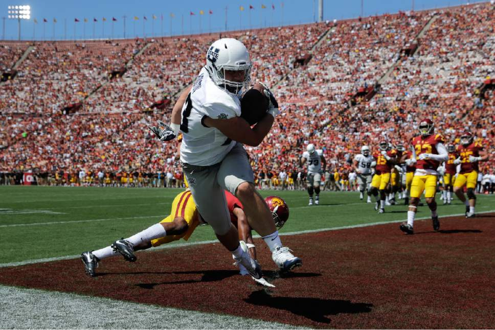 Utah State tight end Wyatt Houston scores a touchdown during the second half of an NCAA college football game against Southern California, Saturday, Sept. 10, 2016, in Los Angeles. USC won 45-7. (AP Photo/Jae C. Hong)