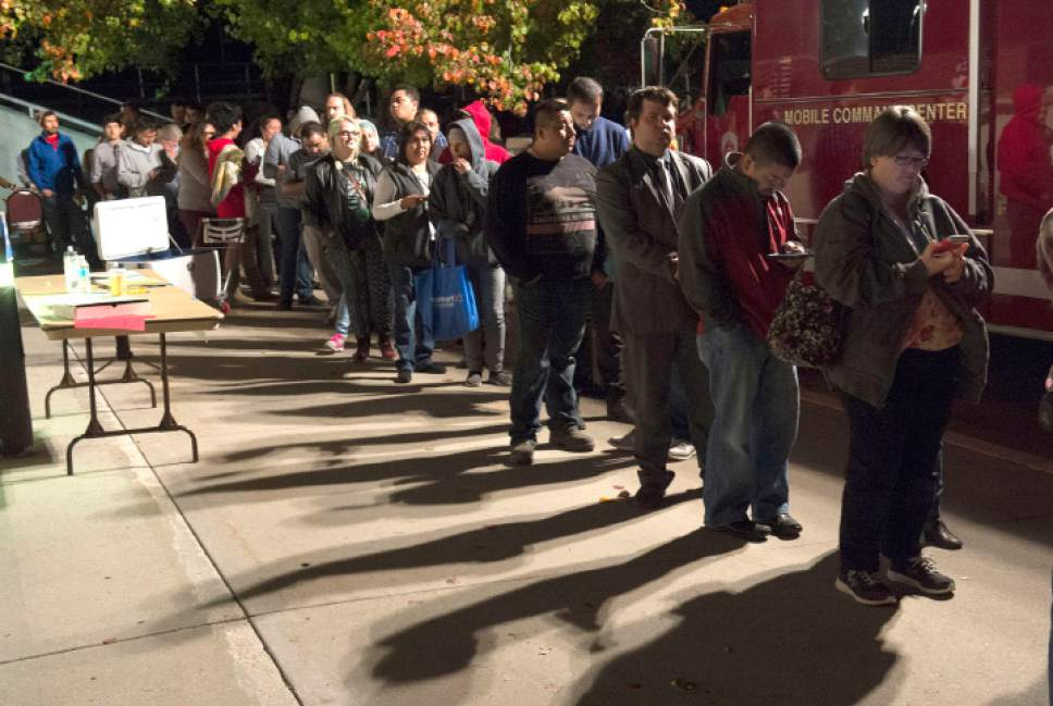 Rick Egan  |  The Salt Lake Tribune  With 30 minutes left to vote, there are still long lines outside the West Valley City Hall, Tuesday, November 8, 2016.