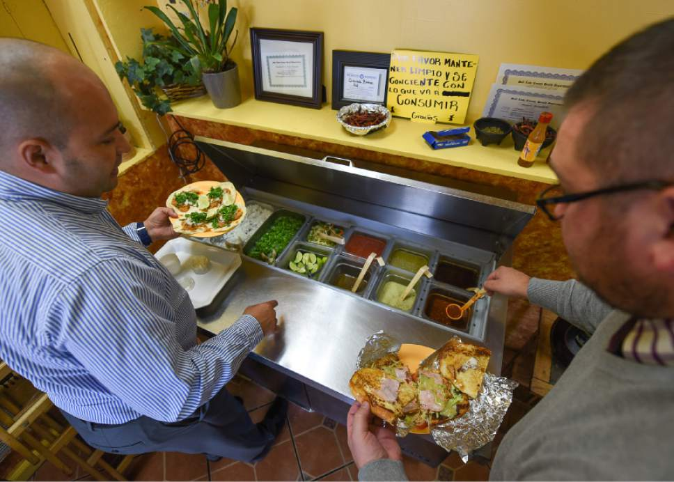 Francisco Kjolseth | The Salt Lake Tribune Supplementing their order of cochinita tacos and a large torta sandwich, Luis Avilla, left, and Adam Joynt stop in for lunch at Los Molcajetes in West Valley City.