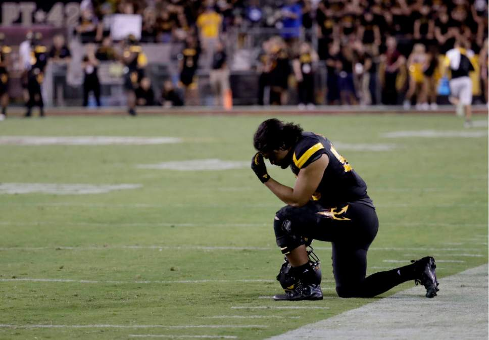 Arizona State linebacker Salamo Fiso kneels on the sidelines after a Utah touchdown during the second half of an NCAA college football game, Thursday, Nov. 10, 2016, in Tempe, Ariz. (AP Photo/Matt York)