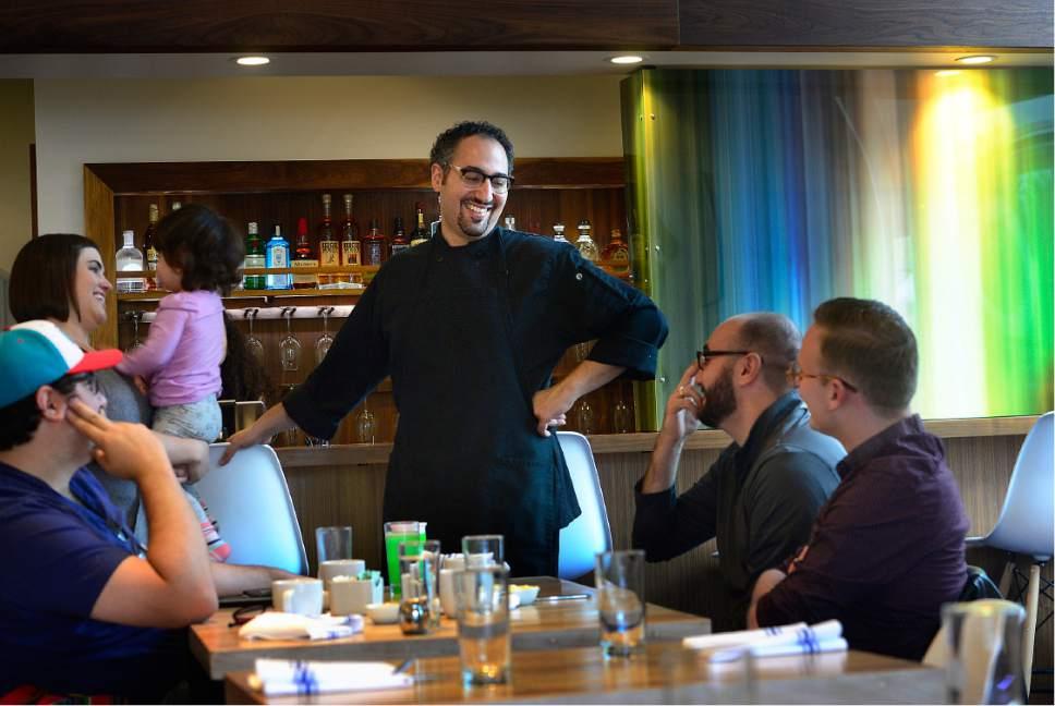 Scott Sommerdorf      The Salt Lake Tribune   Chef / owner Manoli Katsanavas chats with brunch guests at Manoli's in Salt Lake City.