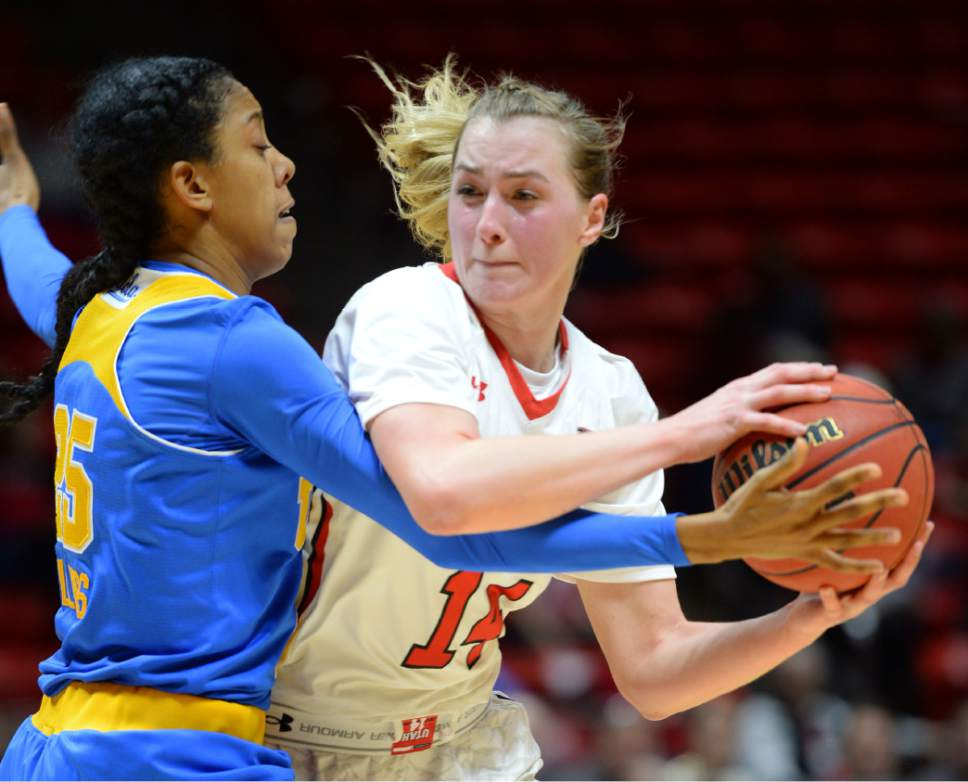 Steve Griffin  |  The Salt Lake Tribune   Utah Utes guard Paige Crozon (14) tries to muscle her way past UCLA's Monique Billings during basketball game at the Huntsman Center in Salt Lake City, Sunday, January 31, 2016.