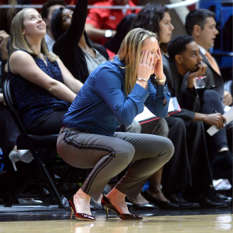 Steve Griffin  |  The Salt Lake Tribune   University of Utah head basketball coach Lynne Roberts holds her face a screams in disbelief after a foul was called on her team during game against UCLA at the Huntsman Center in Salt Lake City, Sunday, January 31, 2016.