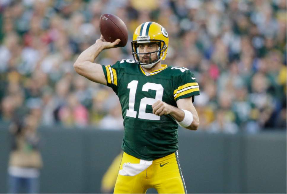 In this photo taken Nov. 6, 2016, Green Bay Packers' Aaron Rodgers throws during the first half of an NFL football game against the Indianapolis Colts Sunday, in Green Bay, Wis. (AP Photo/Jeffrey Phelps)