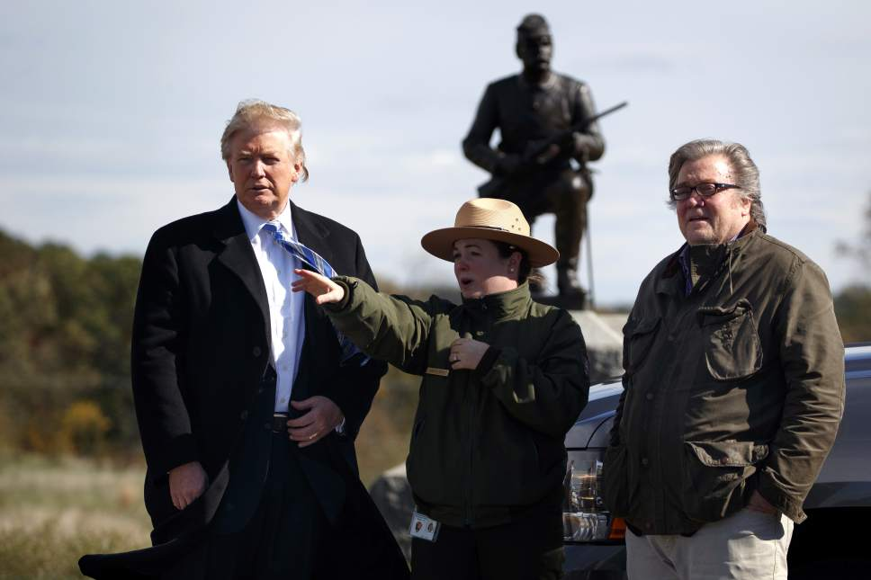 Interpretive park ranger Caitlin Kostic, center, gives a tour near the high-water mark of the Confederacy at Gettysburg National Military Park to Republican presidential candidate Donald Trump, left, and campaign CEO Steve Bannon, Saturday, Oct. 22, 2016, in Gettysburg, Pa. (AP Photo/ Evan Vucci)