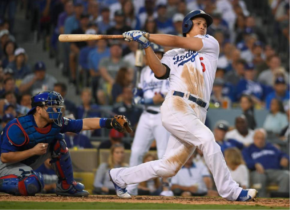 FILE - In this Oct. 18, 2016, file photo, Los Angeles Dodgers' Corey Seager hits an RBI single during the third inning of Game 3 of the National League baseball championship series against the Chicago Cubs, in Los Angeles. Corey Seager of the Los Angeles Dodgers is the favorite in the NL, while Michael Fulmer of Detroit and Gary Sanchez of the New York Yankees are top contenders in the AL when the Rookie of the Year awards are announced Monday night, Nov. 14, 2016. (AP Photo/Mark J. Terrill, File)