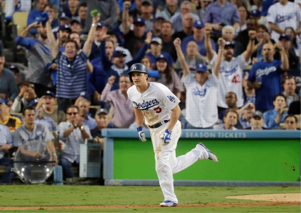 FILE - In this Oct. 18, 2016, file photo, Los Angeles Dodgers' Corey Seager hits an RBI single during the third inning of Game 3 of the National League baseball championship series against the Chicago Cubs, in Los Angeles. Corey Seager of the Los Angeles Dodgers is the favorite in the NL, while Michael Fulmer of Detroit and Gary Sanchez of the New York Yankees are top contenders in the AL when the Rookie of the Year awards are announced Monday night, Nov. 14, 2016. (AP Photo/Jae C. Hong, File)