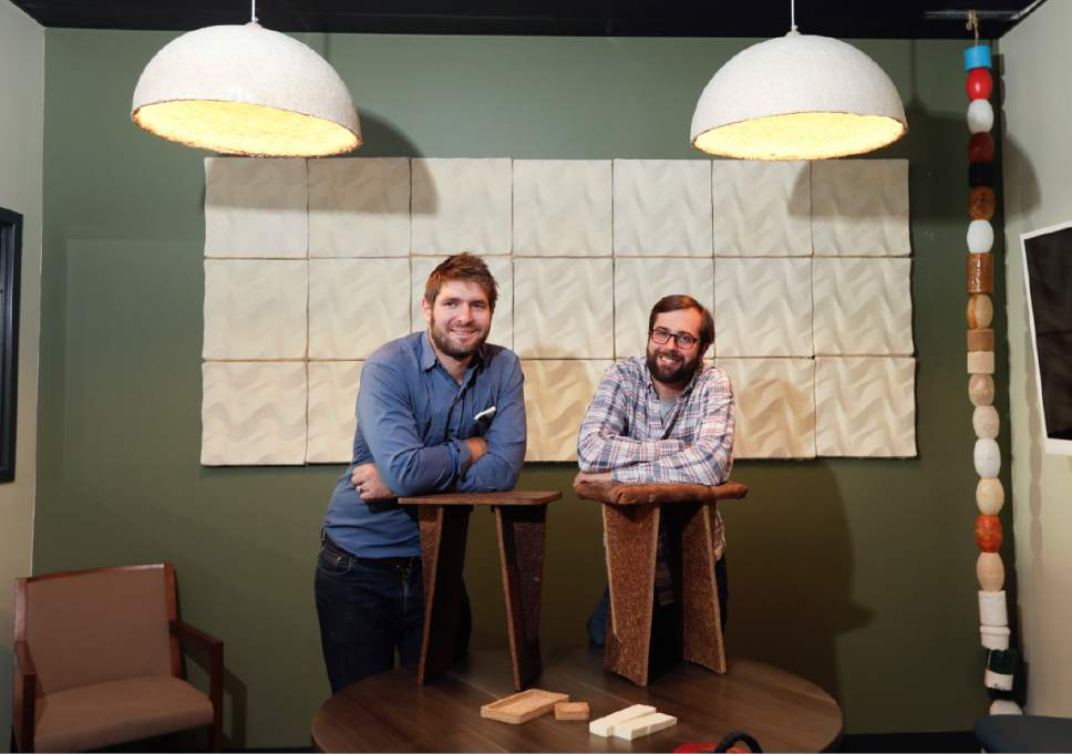 "In this Sept. 27, 2016 photo, Ecovative Design co-founders Eben Bayer, left, and Gavin McIntyre pose in Green Island, N.Y. Ecovative Design is a business staking its growth on mycelium, the thread-like ""roots"" of mushrooms. The mycelium grows around small pieces of stalks and stems to create a bound-together material that can be molded into soft packaging for glassware or pressed into the boards used for the footstools they recently began selling. (AP Photo/Mike Groll)"