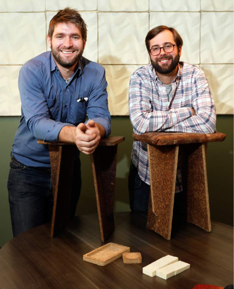 In this Sept. 27, 2016 photo, Ecovative Design co-founders Eben Bayer, left, and Gavin McIntyre pose in Green Island, N.Y. McIntyre and Bayer have been harnessing mushroom power since they were Rensselaer Polytechnic Institute students growing fungus under their beds for a class project a decade ago. Today, they employ about 90 people in a business that found initial success selling a compostable alternative to plastic foams used for packaging items like computers and glass bottles. (AP Photo/Mike Groll)