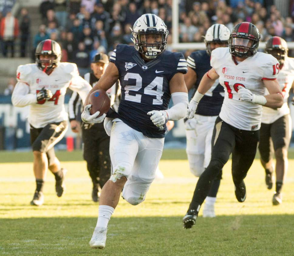 Rick Egan  |  The Salt Lake Tribune  Brigham Young running back Algernon Brown (24) beats his defenders to the end zone, as he runs for a long touchdown for the Cougars, as BYU defeated the Fresno Bulldogs 52 -10, at Lavell Edwards stadium, Tuesday, November 21, 2015.