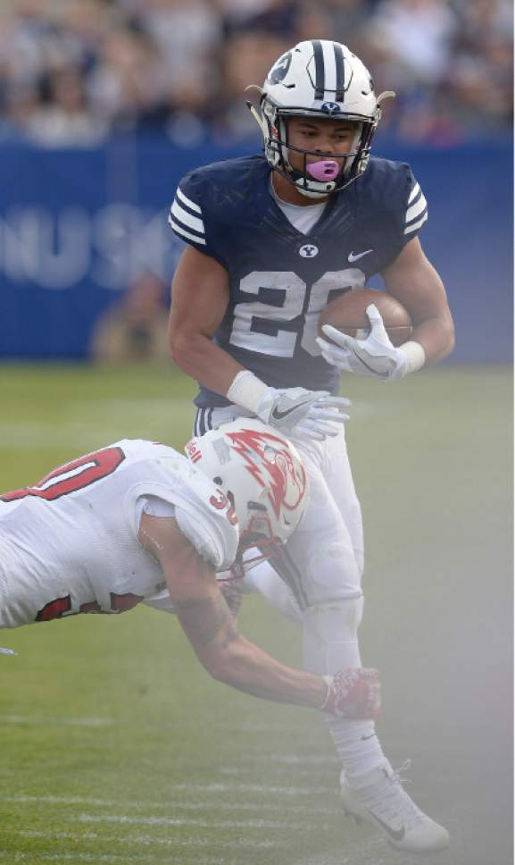 Leah Hogsten  |  The Salt Lake Tribune Brigham Young Cougars defensive back Kj Hall (20) is taken down by Southern Utah Thunderbirds safety Tyler Collet (30). Brigham Young University defeated Southern Utah University 37-7 during their first match up at LaVell Edwards Stadium,  Saturday, November 12, 2016.