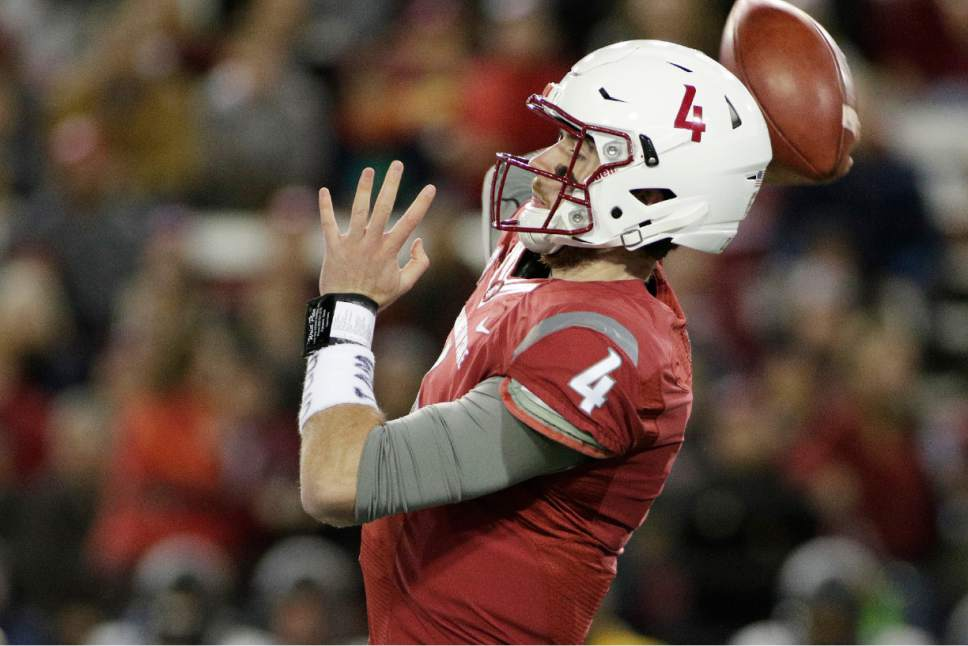 Washington State quarterback Luke Falk (4) throws a pass during the first half of an NCAA college football game against California in Pullman, Wash., Saturday, Nov. 12, 2016. (AP Photo/Young Kwak)