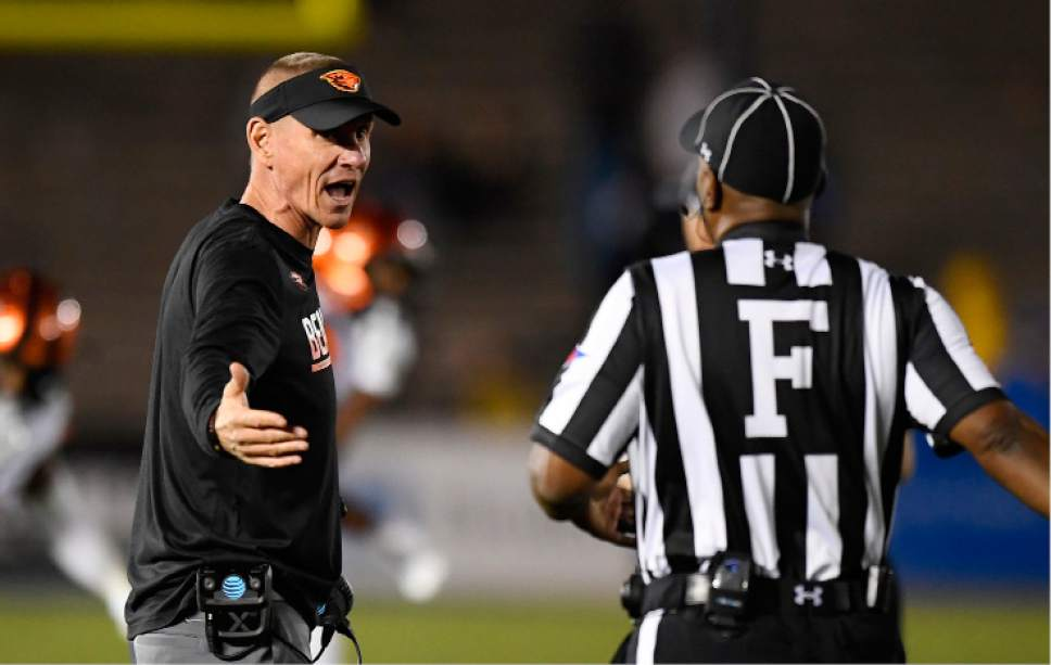 Oregon State coach Gary Andersen, left, yells at an official after UCLA intercepted a pass and ran it in for a touchdown during the second half of an NCAA college football game, Saturday, Nov. 12, 2016, in Pasadena, Calif. UCLA won 38-24. (AP Photo/Mark J. Terrill)