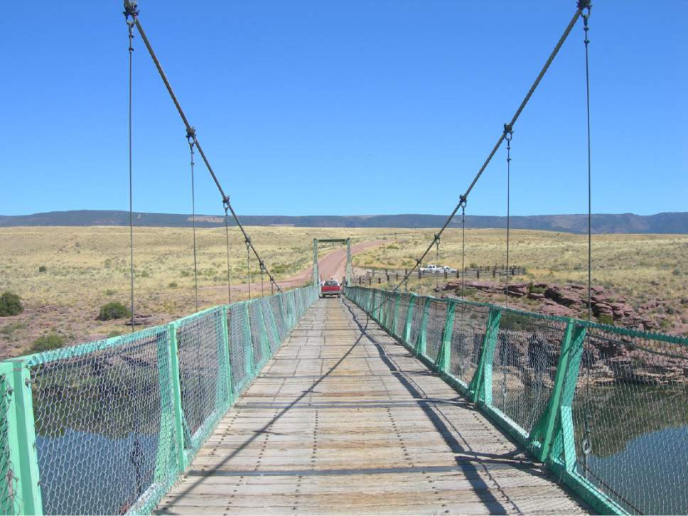 |  Courtesy of Jimmy Emerson  Utah officials want to help pay for the reconstruction of Browns Park Swinging Bridge just inside Colorado. Among the West's last surviving swinging bridges, it was rendered unusable in 2014 when a tractor broke through its decking.