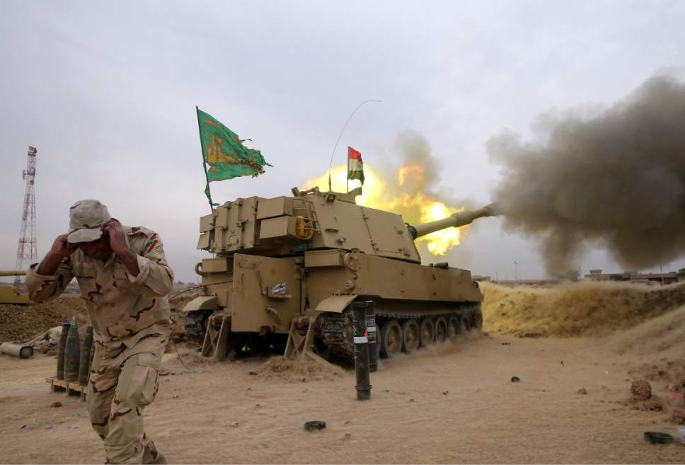 The Iraqi army fires a 155mm shell towards Islamic State militant positions in Mosul, from the village of Ali Rash, east of Mosul, Iraq, Tuesday, Nov. 15, 2016. Iraq launched a major offensive last month to drive IS out of the northern city, the country's second largest, which is still home to more than 1 million civilians. (AP Photo/Hussein Malla)