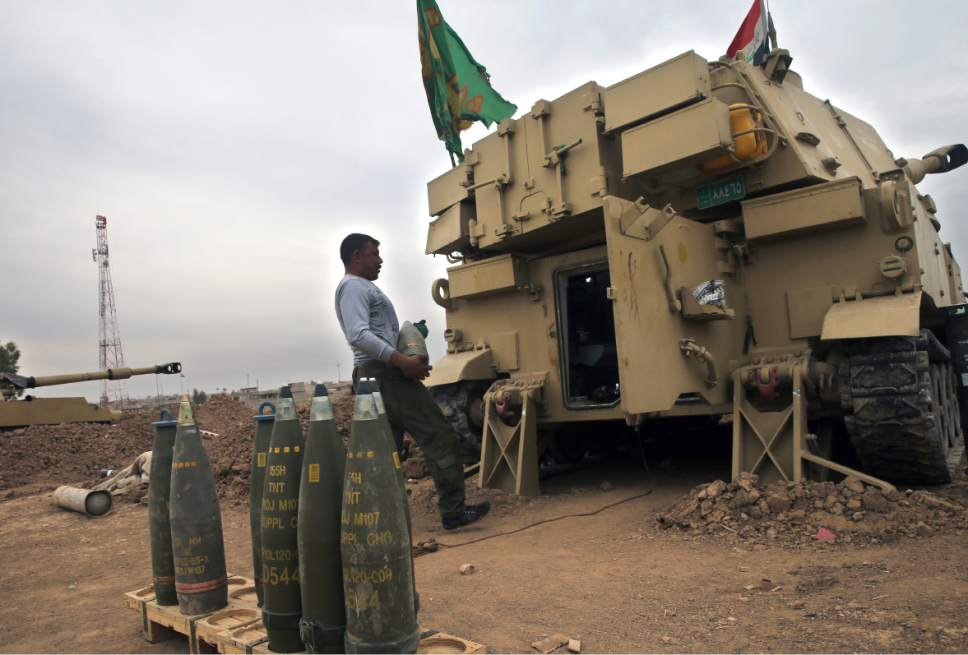 The Iraqi army prepares to fire a 155mm shell towards Islamic State militant positions in Mosul, from the village of Ali Rash, east of Mosul, Iraq, Tuesday, Nov. 15, 2016. Iraq launched a major offensive last month to drive IS out of the northern city, the country's second largest, which is still home to more than 1 million civilians. (AP Photo/Hussein Malla)