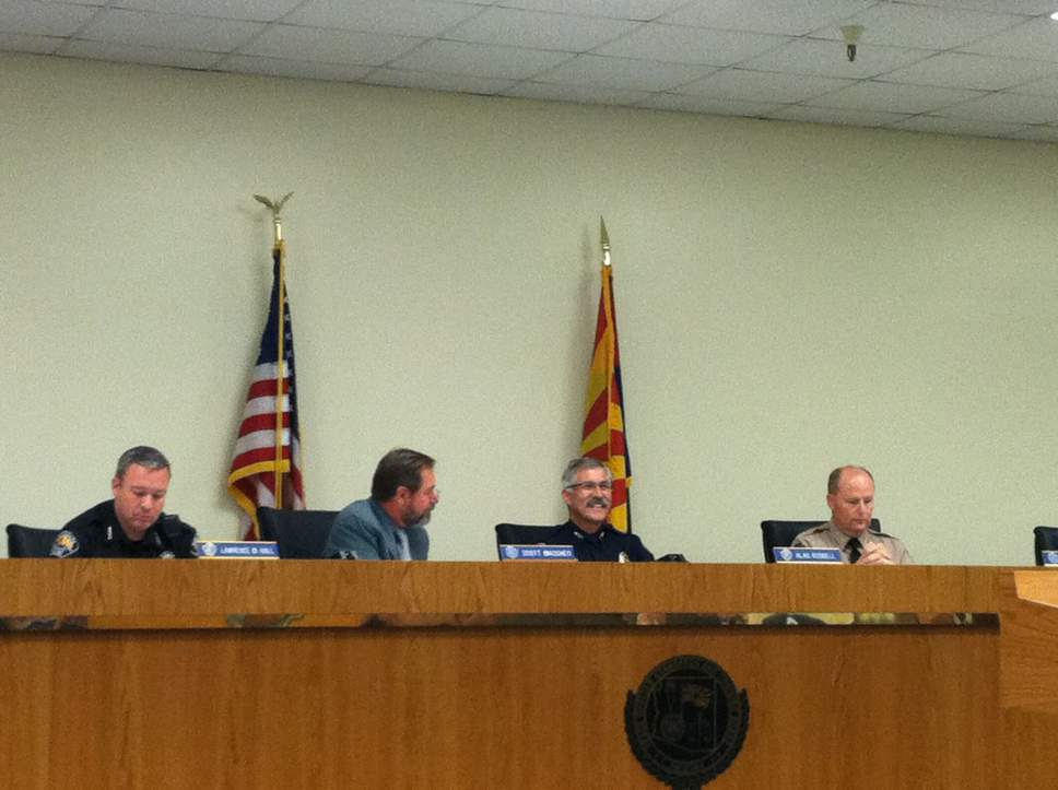 Nate Carlisle  |  Salt Lake Tribune Members of the Arizona Peace Officer Standards and Training Board, from left Lawrence M. Hall, Scott Mascher, Alan Rodbell, and Mark J. Danels, listen Nov. 16, 2016. The board considered whether to discipline six marshals from the polygamous towns of Colorado City, Ariz., and Hildale, Utah.