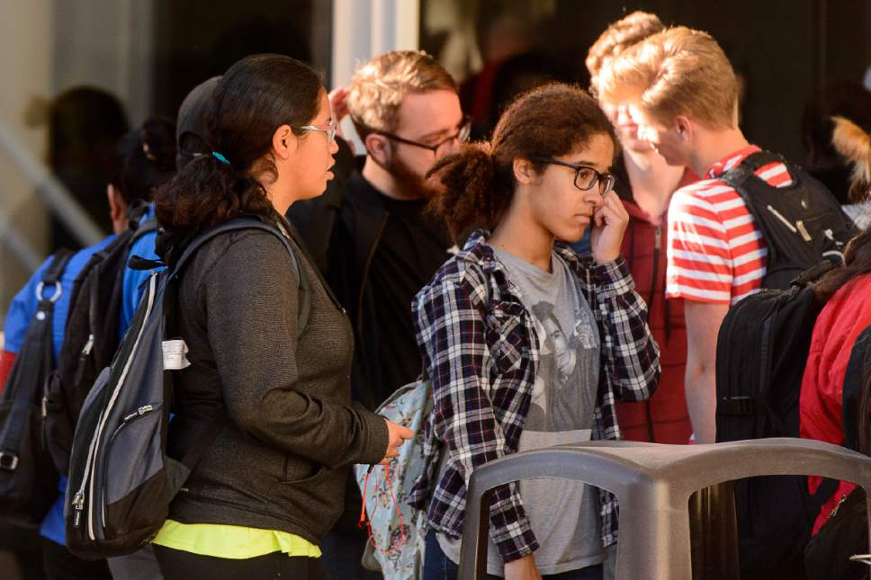 Trent Nelson  |  The Salt Lake Tribune Students gather after a 16-year-old boy allegedly stabbed several other male students before reportedly turning his knife on himself at Mountain View High School in Orem last week.