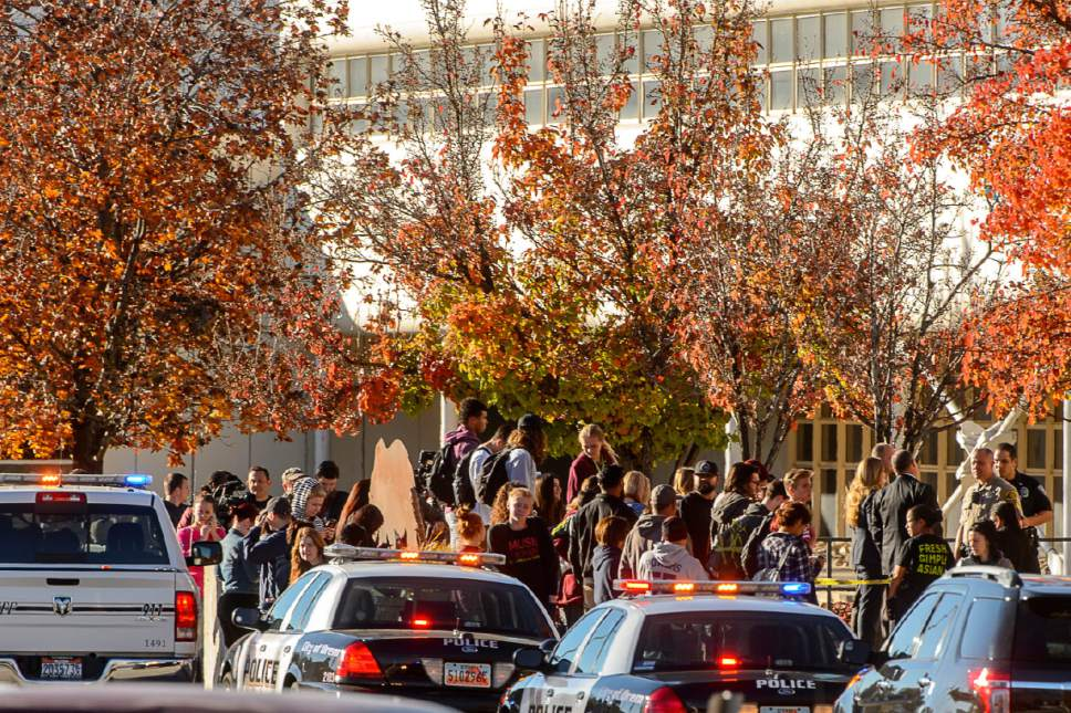 Trent Nelson  |  The Salt Lake Tribune Law enforcement, students, parents and media gather after a 16-year-old boy allegedly stabbed several other male students before reportedly turning his knife on himself at Mountain View High School in Orem Tuesday November 15, 2016.