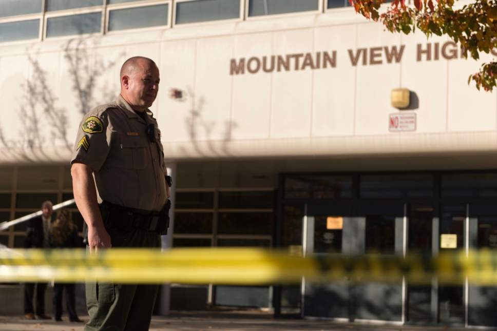 Trent Nelson | The Salt Lake Tribune  A Utah County Sheriff's deputy stands outside Mountain View High School Tuesday, Nov. 15, where five students were stabbed and one student was arrested, according to Orem police officials.