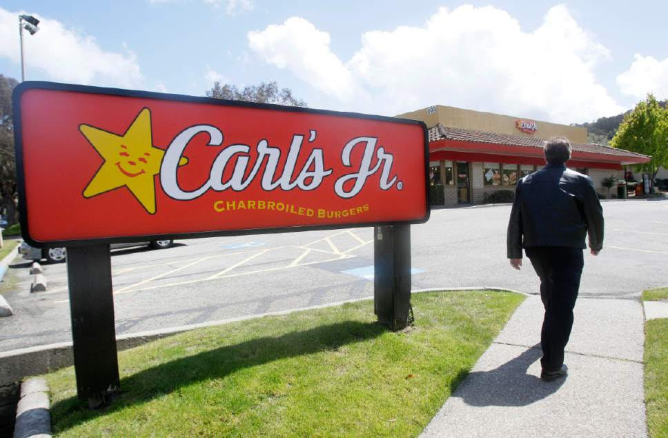 A man walks past a sign for a Carl's Jr. restaurant in San Bruno, Calif., Wednesday, May 25, 2011. Republican lawmakers have made an overhaul of California's business regulations one of their main negotiating points in talks to close the budget deficit, and with the state mired in slow job growth and businesses stepping up the clamor for relief they're hearing some indications of support from Democrats. (AP Photo/Jeff Chiu)