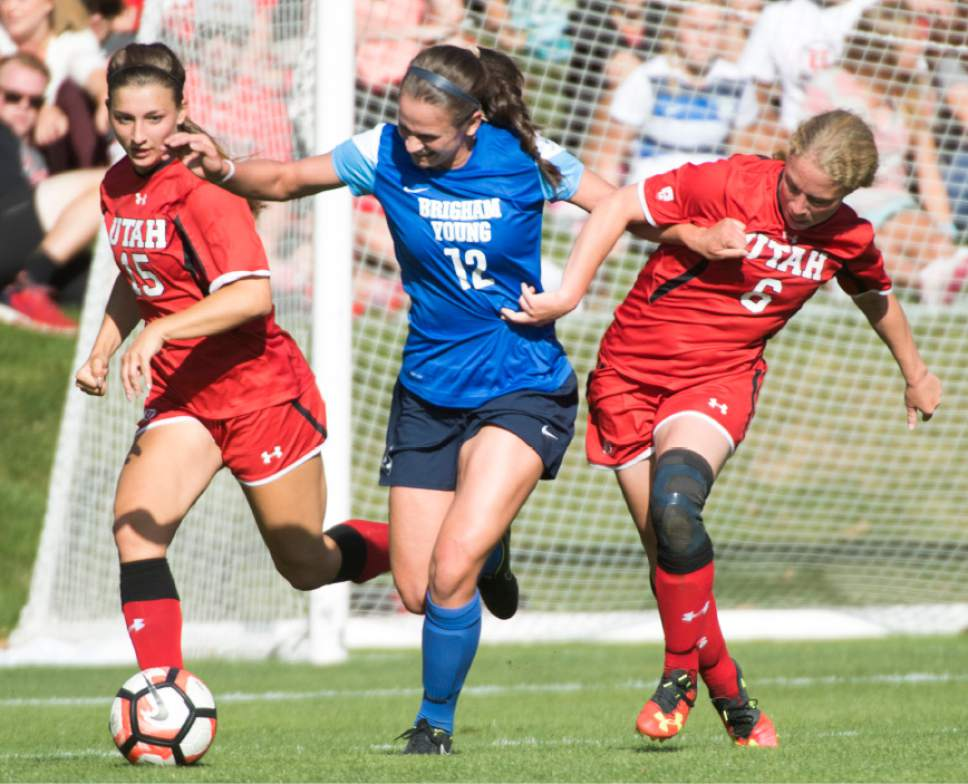 Rick Egan  |  The Salt Lake Tribune  Avery Calton Walker, (12) heads down the field with the ball, as Natalie Vukic (15), and Paola van der Veen (6)Utah, defend, in soccer action, BYU vs. Utah, at the Ute soccer field, Monday, September 5, 2016.