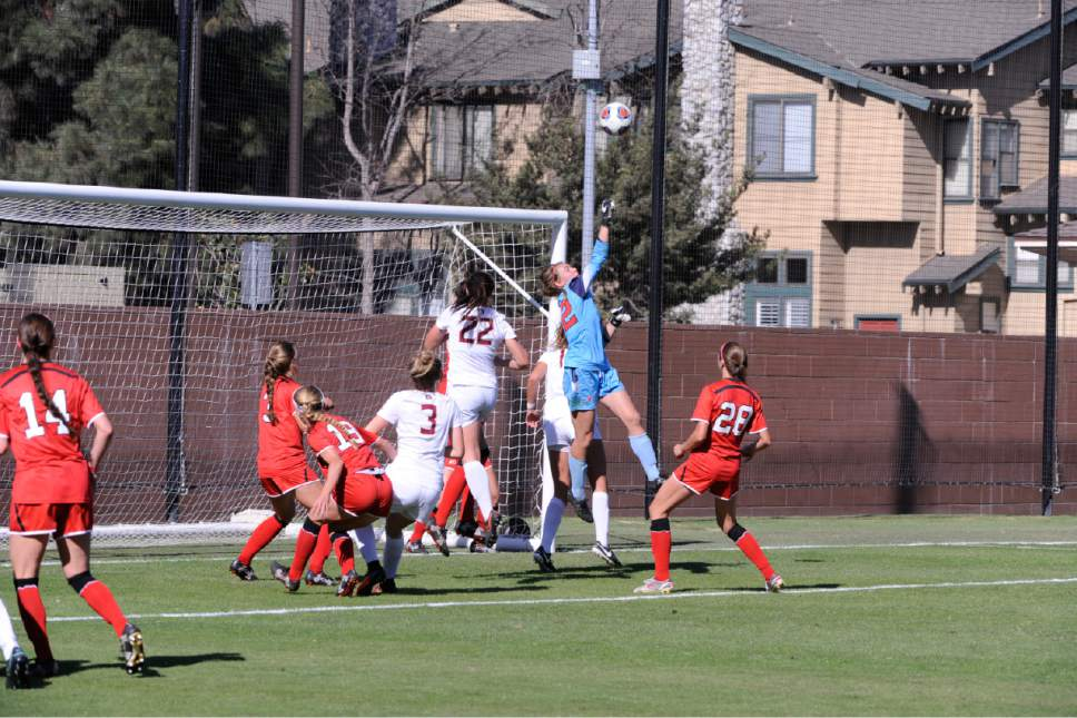 |  courtesy Utah Athletics  Sophomore keeper July Mathias punches out a second-half attempt by Florida State in Utah's 2-1 win on Nov. 18, 2016 in Los Angeles. The Utes advanced to the third round of the NCAA Tournament for the first time in program history.