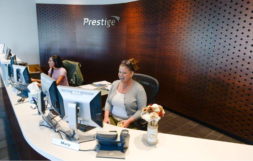 Francisco Kjolseth | The Salt Lake Tribune Mary Whitchurch, left, and Mary McGill, greet visitors to Prestige Financial, a large credit financing company in Salt Lake City that is almost universally praised by its employees as a great place to work.