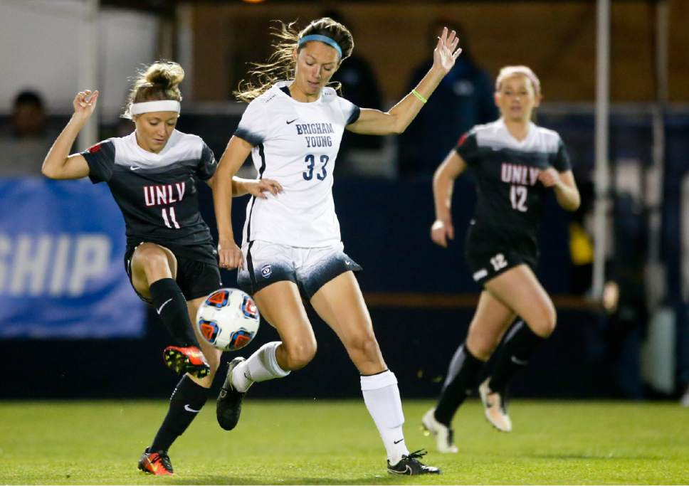 BYU forward Ashley Hatch (33) competes for possession of the ball with UNLV midfielder Sophie Cortes (11) during a first-round game in the NCAA women's soccer tournament Friday, Nov. 11, 2016, in Provo, Utah. (Isaac Hale/The Daily Herald via AP)