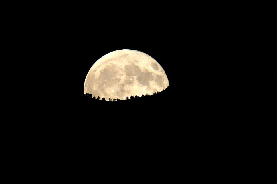 Scott Sommerdorf      The Salt Lake Tribune   The Harvest Moon rises over the ridge as seen from Syracuse. Syracuse beat Viewmont 13-6, Friday, September 16, 2016.