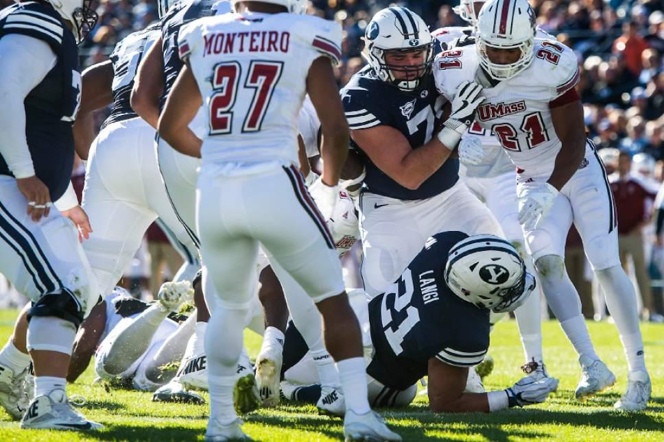 Chris Detrick  |  The Salt Lake Tribune Brigham Young Cougars linebacker Harvey Langi (21) scores a touchdown during the game at LaVell Edwards Stadium Saturday November 19, 2016.