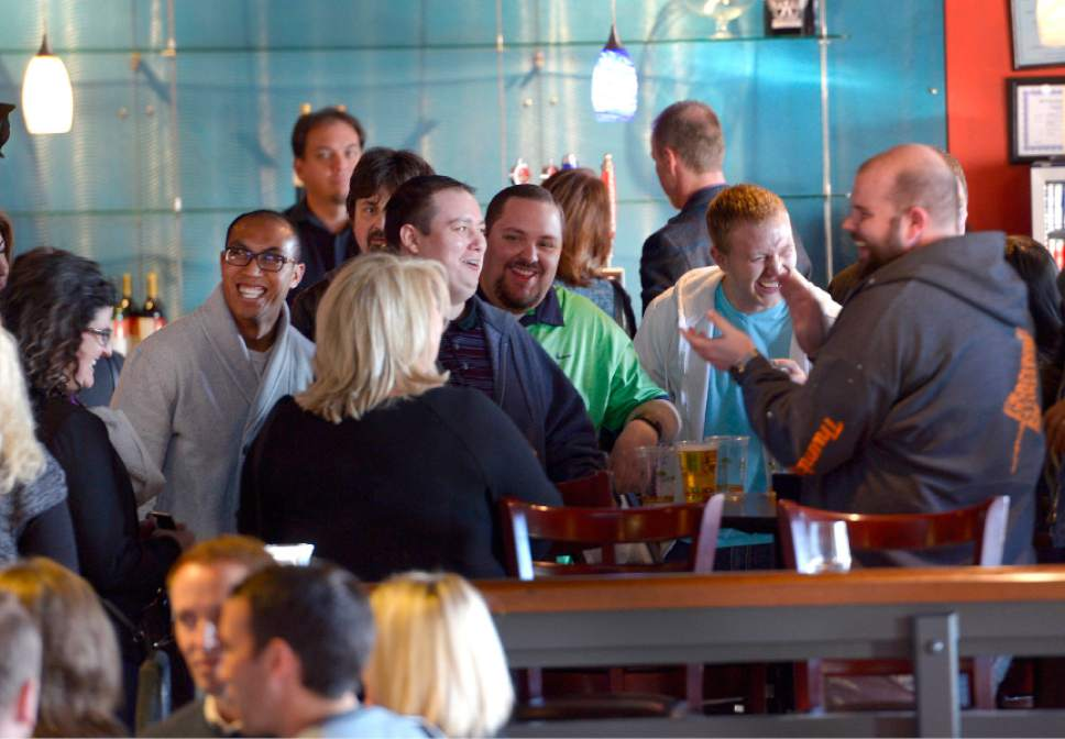 Leah Hogsten  |  The Salt Lake Tribune Thumbtack employees share a laugh last year after the company was named the best midsize company, an honor they collected again this year.