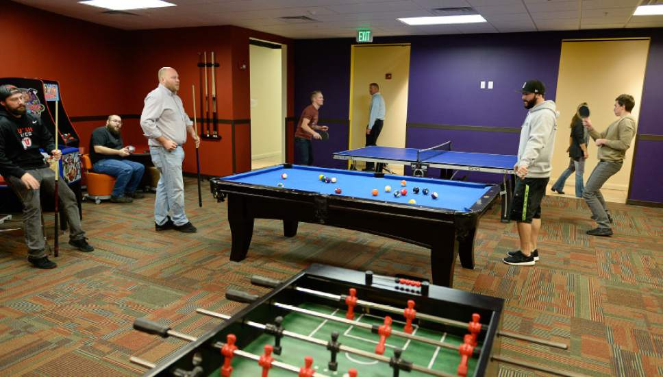 Francisco Kjolseth  |  The Salt Lake Tribune Employees of CHG Healthcare Services near Big Cottonwood Canyon unwind in the Fun Room.
