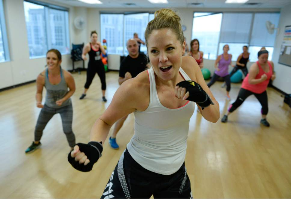 Francisco Kjolseth  |  The Salt Lake Tribune A kickboxing workout at work? That's one of the perks at CHG Healthcare Services, where employee Cicely Taylor runs a class. Such benefits help companies recruit and retain staffers.