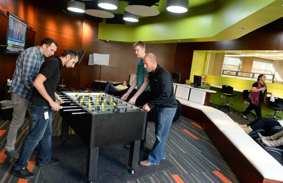 Francisco Kjolseth | The Salt Lake Tribune Kyle McDonald, left, Orlando Accetty, Lyman Rasmussen and Randy Tarbet, all members of the IT department, unwind in the lounge of Prestige Financial, a large credit financing company in Salt Lake City.