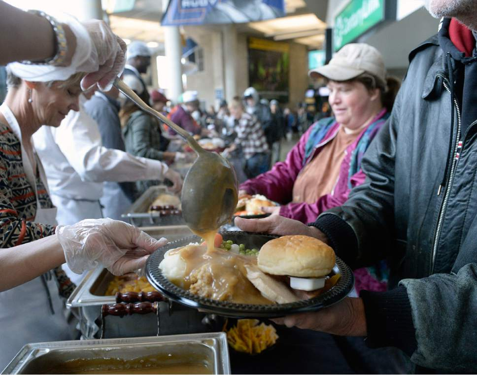 "Al Hartmann  |  The Salt Lake Tribune Some 200 volunteers help serve up to 4,000 hot traditional Thanksgiving meals to local homeless and low income individuals at the The 18th annual ""We Care - We Share"" at the  Vivint Smart Home Arena Monday, Nov. 21.  This event is part of the NBA Cares Season of Giving.  It was in In collaboration with the Salt Lake City Mission, Utah Food Services, All-Star Catering, the Miller family and Larry H. Miller Sports & Entertainment.   employees will serve a warm, traditional Thanksgiving meal to thousands of residents in need.  The annual gathering will also had winter clothing distribution, musical entertainment courtesy of the Salt Lake City Mission and activity packets for children."