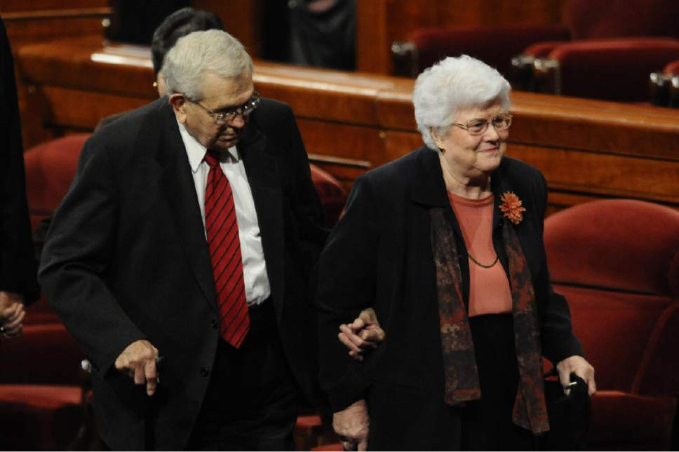 Courtesy  |  LDS Church  President Boyd K. Packer leaves the October 2010 general conference with his wife, Donna.