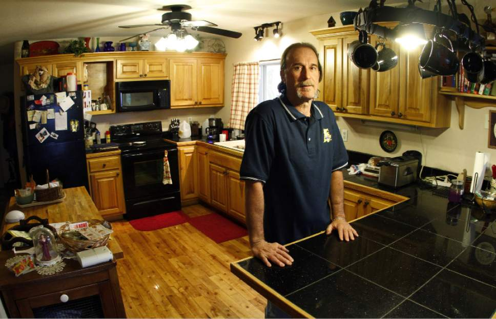In this April 19, 2013 photo, Ray Krone poses at his home in Newport, Tenn. Krone was convicted in 1992 and again in 1996, after winning a new trial, in the death of a Phoenix bartender found naked and stabbed in the men's restroom of her workplace. A forensic dentist testified at both trials that bite marks on the bartender's breast and neck could have come only from Krone. The jury at Krone's second trial found him guilty despite three top forensic dentists who testified for the defense that Krone couldn't have made the bite mark. In 2002, DNA testing matched a different man, proving Krone's innocence, and he was released. (AP Photo/Wade Payne)