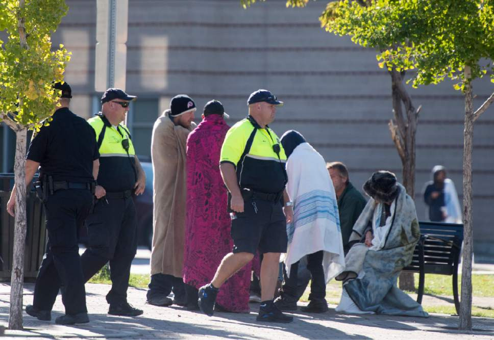 Rick Egan  |   Tribune file photo Salt Lake City police make their rounds amount the homeless people in the Rio Grande neighborhood in October.
