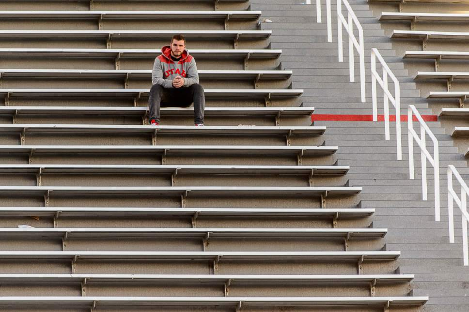 Trent Nelson  |  The Salt Lake Tribune A Utah fan sites alone after the loss to Oregon, NCAA football at Rice-Eccles Stadium in Salt Lake City, Saturday November 19, 2016.