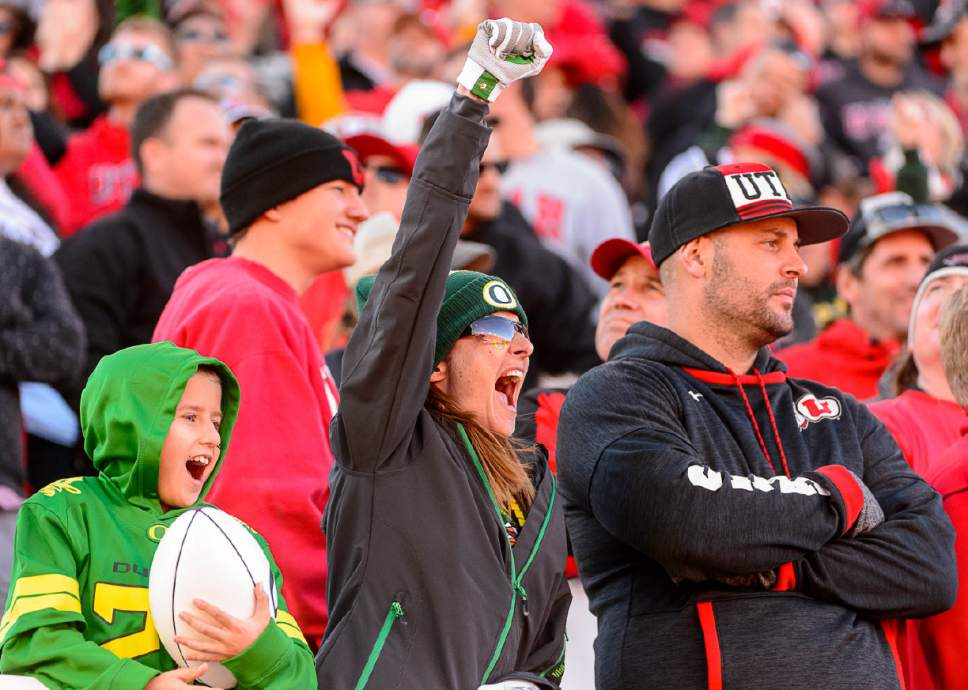 Trent Nelson  |  The Salt Lake Tribune Fans react to the game-winning touchdown instant replay decision as Utah hosts Oregon, NCAA football at Rice-Eccles Stadium in Salt Lake City, Saturday November 19, 2016.
