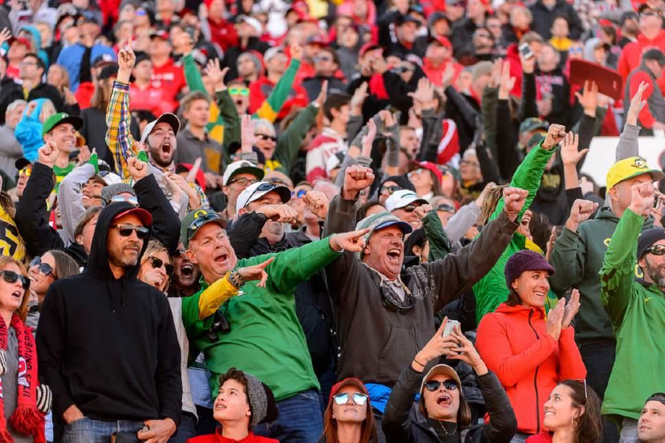 Trent Nelson  |  The Salt Lake Tribune Oregon fans celebrate the win as Utah hosts Oregon, NCAA football at Rice-Eccles Stadium in Salt Lake City, Saturday November 19, 2016.