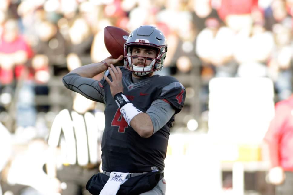 Washington State quarterback Luke Falk (4) throws a pass during warm ups before an NCAA college football game against Arizona in Pullman, Wash., Saturday, Nov. 5, 2016. (AP Photo/Young Kwak)