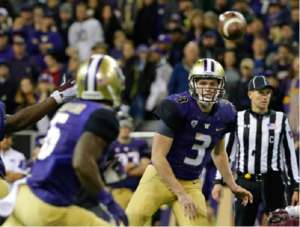 Washington quarterback Jake Browning (3) passes to wide receiver Chico McClatcher, left, in the second half of an NCAA college football game against Arizona State, Saturday, Nov. 19, 2016, in Seattle. Washington beat Arizona State 44-18. (AP Photo/Ted S. Warren)