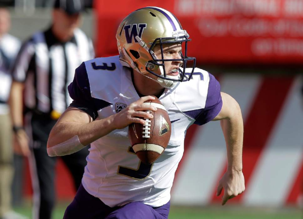 FILE - In this Saturday, Oct. 29, 2016, file photo, Washington quarterback Jake Browning (3) rolls out as he looks down field in the first half of an NCAA college football game against Utah  in Salt Lake City. Browning was solid, 186 yards passing, two touchdowns and an interception, in their victory against Utah. (AP Photo/Rick Bowmer, File)