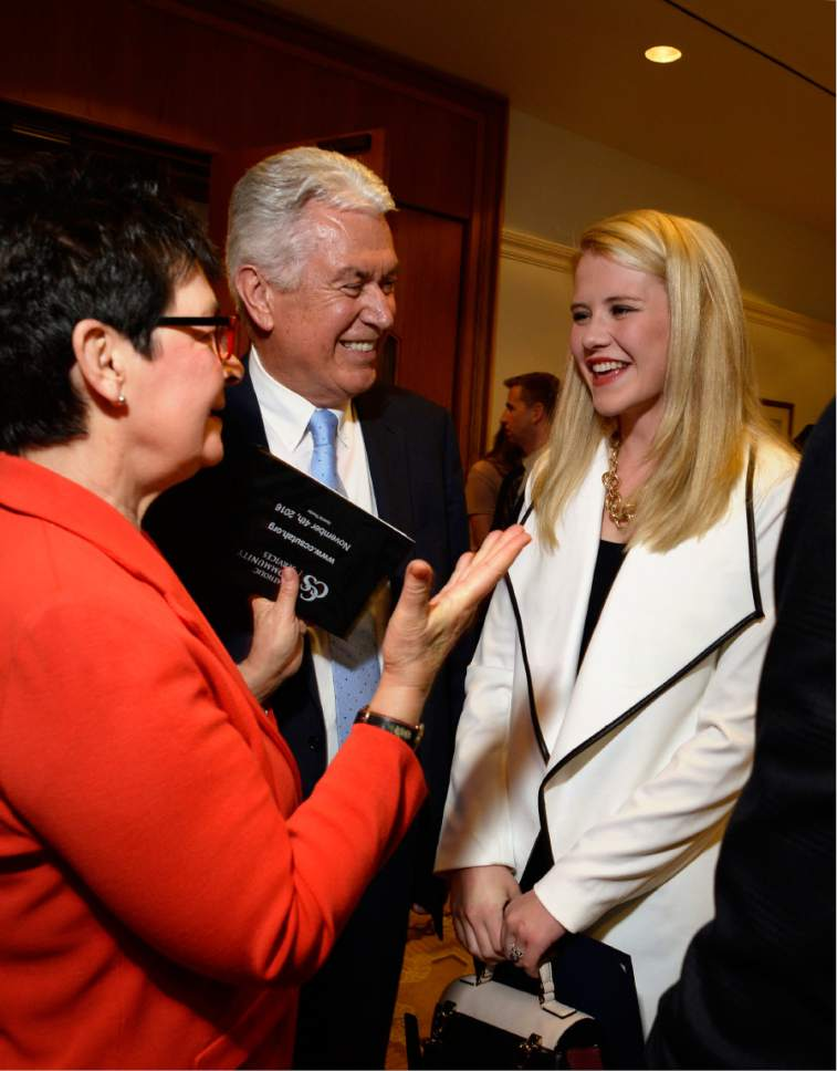 Scott Sommerdorf   |  The Salt Lake Tribune   Harriet Reich Uchtdorf, left, wife of LDS President Dieter F. Uchtdorf, center, greets Elizabeth Smart at a reception prior to the Catholic Community Services of Utah Humanitarian Awards dinner at the Little America Hotel on Friday.
