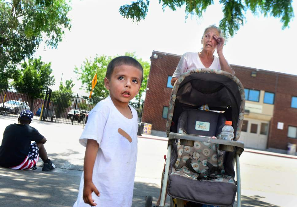 Scott Sommerdorf   |   Tribune  file photo Kathy Maestas is homeless along with her 3-year-old grandson, Navin, on Rio Grande Street near the Salt Lake Road Home, Friday, July 8, 2016.